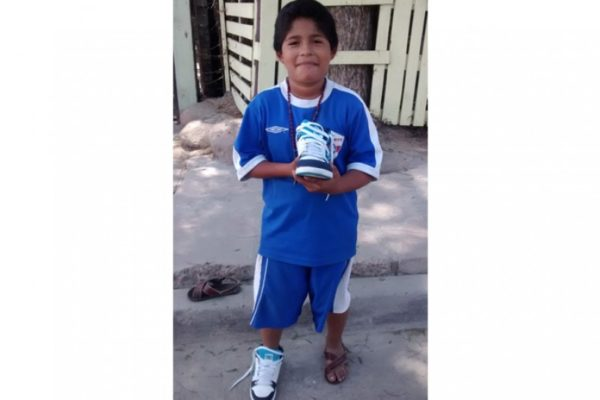 Student, Juan Garcia showing off his new pair of shoes!